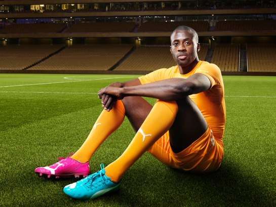 Yaya Touré in the 2014 Ivory Coast Home Kit that features PUMA's PWR ACTV Technology